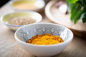 A bowl of turmeric powder