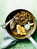 Fried seabass with lentils and tzatziki