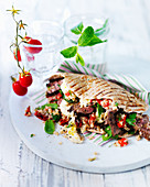 Pitta flatbread with lamb, mint, quinoa, hummus and red peppers