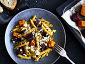 Kamut penne with beetroot, pumpkin and turmeric