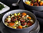 Cabbage stew with pumpkin and Mettenden (smoked pork sausage)