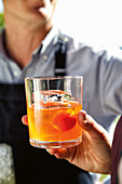 Negroni with Gin, Vermouth, Aperol and cherry tomato