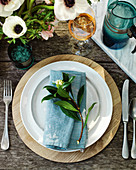 Place setting with a cloth napkin and flowers
