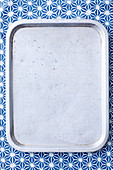 Grey tray on blue background