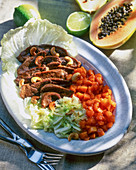 Duck breast with Chinese cabbage, papaya and cashews