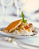 Red mullet with seafood on risotto