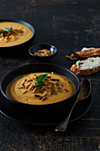 Sweet potato soup, with pine nuts