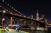 A view of Brooklyn Bridge lit up in the evening, New York City, USA