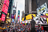A mass of people at the intersection of Broadway and 42nd Street, New York City, USA