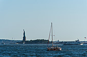 The Hudson River with a view of the Statue of Liberty, Manhattan, New York City, USA