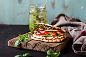 Vegan waffle sandwich with grilled vegetables and pesto