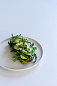 Delicious toast with fresh vegetables and herbs on plate