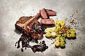 Grilled Porterhouse steak with mushrooms, leeks and rye breadcrumbs