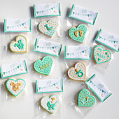 Motif cookies for a baby party, packed in sachets for gifting