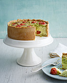 Broccoli quiche with cherry tomatoes on a cake stand
