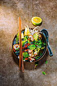 Rice noodle pho with chicken, shiitake and pak choi