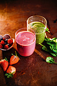 A Popeye green smoothie and a 'Berry Me' smoothie