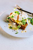 Avocado crispbread with a poached egg and parmesan