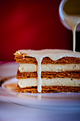 Millefeuille with gold leaf and vanilla sauce