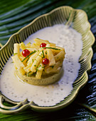 Pistachio flan with pineapple salad in tapioca coconut pudding