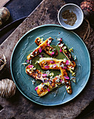 Grilled haloumi with honey and wild flowers