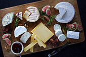Cheese platter with figs, dates and walnuts