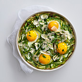 Bread and asparagus bake with parmesan and fried eggs
