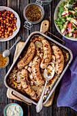 Baked white sausage with mustard marinade