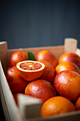 Blood oranges in a wooden box