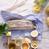 Ingredients for fish kebabs in a potato coating