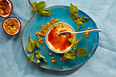 Creme brulee with passion fruit sauce