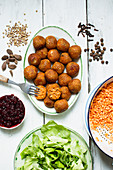 Spicy lentil balls with cranberries and lettuce