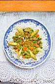 Soy dumplings with asparagus and peas on rice