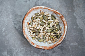 Roasted pumpkin and sunflower seeds in a hand made bowl