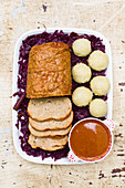 Vegan Sauerbraten with potato dumplings and red cabbage