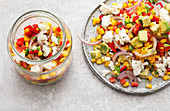 Colourful sweetcorn salad with avocado, peppers and feta cheese to take away