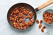 Pecan nuts being roasted