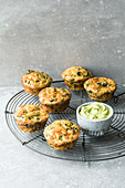 Vegetable muffins with cheese and a green dip