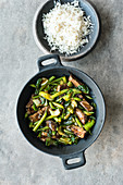 Green stir-fried vegetables with rump steak served with rice