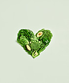 Green vegetables arranged in a heart shape