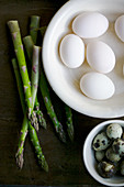 White hens eggs, quails eggs and asparagus still life