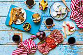 Antipasti picnic with fish, sausage, cheese and wine