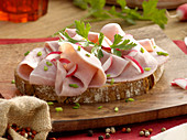 Hearty country bread with cooked ham and parsley