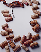 Different wine corks with a corkscrew