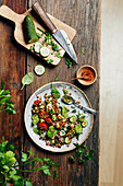 Lentil salad with cucumber, tomato, pesto and baby spinach