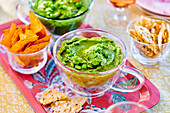 Pea hummus with nachos and crackers