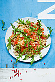 Vegan bulgur salad with tomatoes and arugula