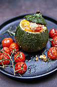 Pumpkin stuffed with millet and vegetables