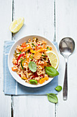 Vegan rice salad with zucchini and peppers