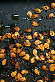 Roast butternut squash seeds with chilli